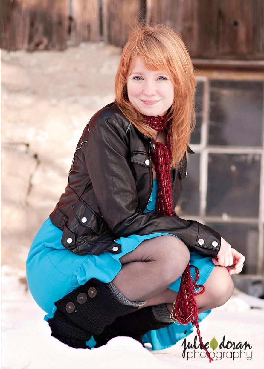 redhead in a blue dress