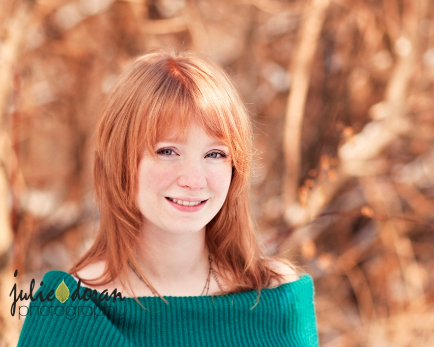 girl with red hair foliage in background