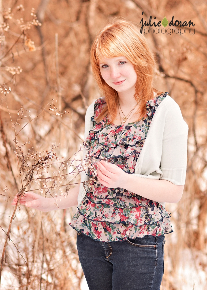 red haired girl with flower