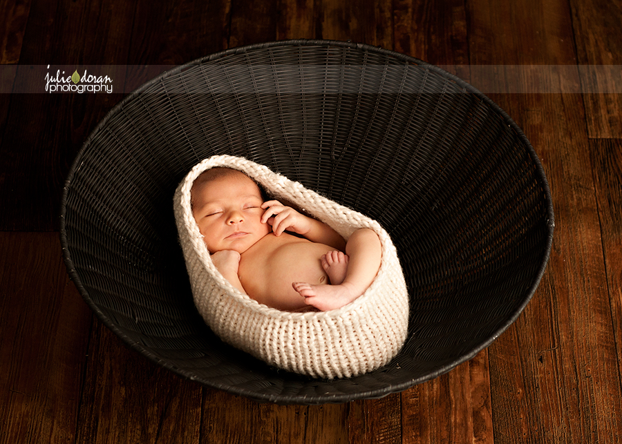 newborn_in_black_basket