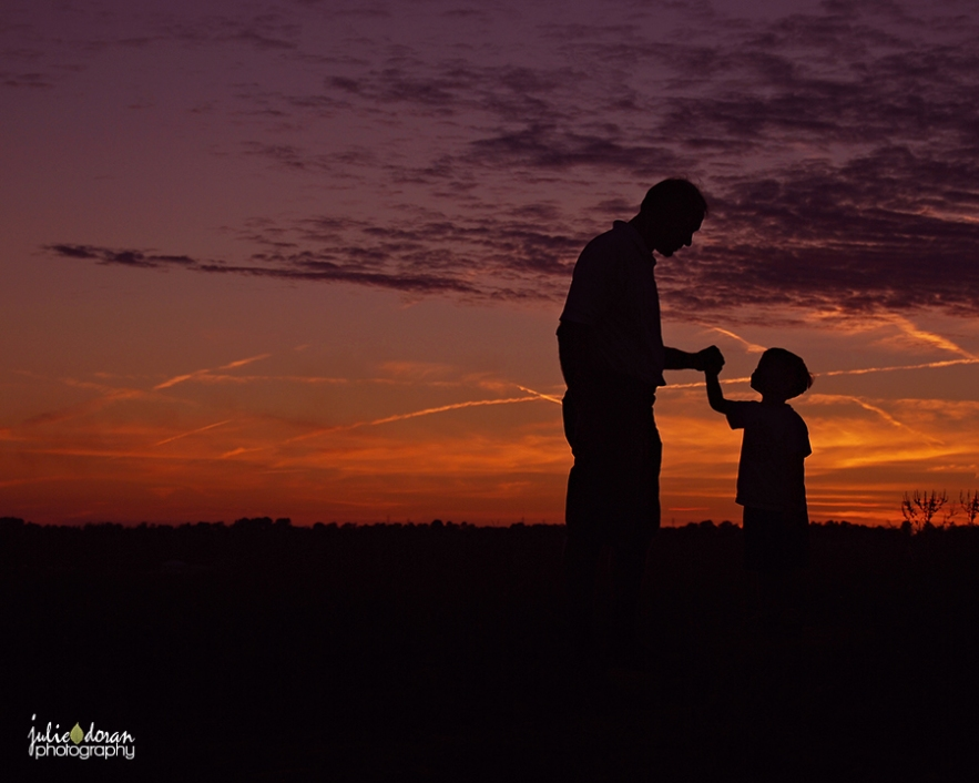 grandpa and grandson sunset