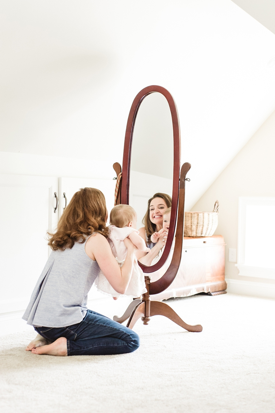 baby and mom vintage mirror reflection