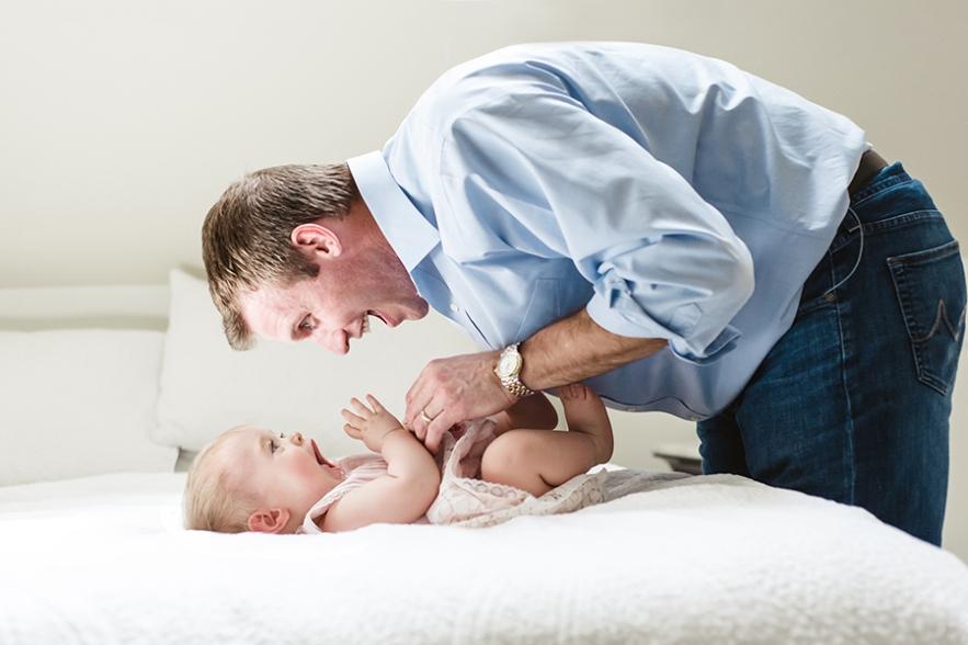 dad_tickling_infant_daughter