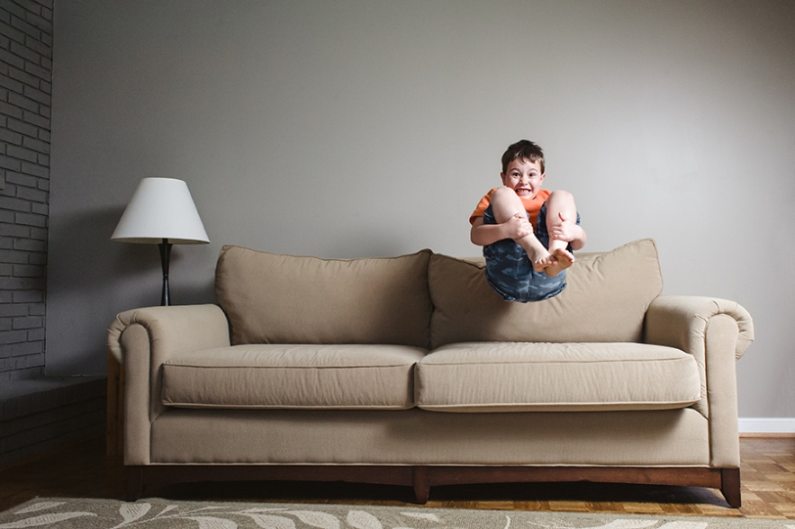 boy jumping couch